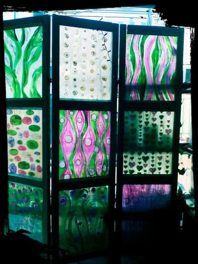 Folding screen (paravane) made of wood and plexiglass. Hand painted, each with different design. Lets light in, but gives intimacy. Dimension 140x 180cm, folds on one-third of its size.
