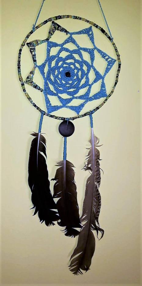 crochet p26cm and feathers found in forest