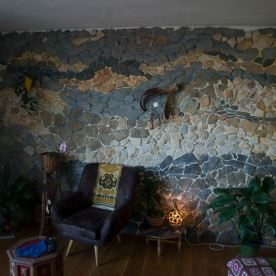 Mosaic wall made of stones found on different locations in nature. Dimensions 5x2,7m