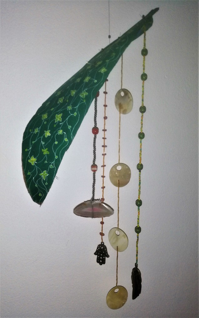 11 mother of pearl, beads, coral on painted palm leaf, 30x50cm